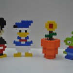 Disney cartoon figures made by Lego bricks by Ray Kwan