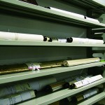Scrolls of old maps and historical documents