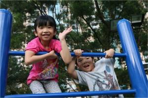 Vanessa Lui Lai-lei's twins climb on a monkey bar.