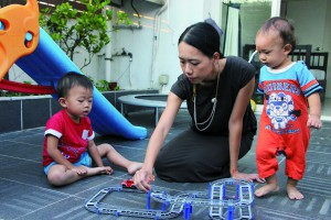 Katherine Lam Suet-ying plays with her sons.