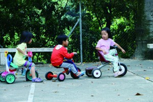 Students from RTC Gaia School pedal around during recess.